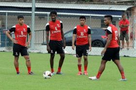 TEAMWORK: LionsXII coach Fandi Ahmad expects Madhu Mohana (No. 6) and his fellow defenders to be protected against Terengganu's attack by the players in front of them.