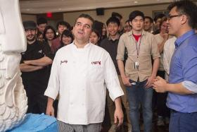 EXCITED: Buddy Valastro (centre) presenting his SG50 cake at the Singapore Night.