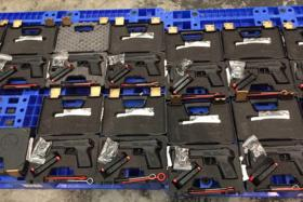 MIX-UP: Some of the guns and ammunition seized by Vietnamese authorities. PHOTOS: COURTESY OF TUOI TRE NEWS