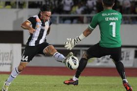 KILLER TOUCHES: Terengganu's Issey Nakajima-Farran twice beat LionsXIl goalkeeper Izwan Mahbud to hand the Singapore side their fifth loss of the season.