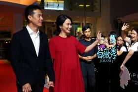 """Joanne Peh and husband Qi Yuwu at the gala premiere of the movie """"1965"""" last month. They welcomed a healthy baby girl on Friday."""