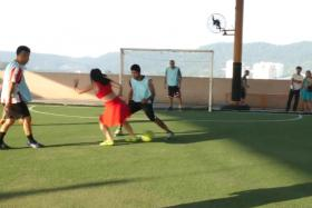 Raquel Benetti tackling an unsuspecting male footballer just before showing them how its done.