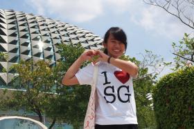 Contest winner Miss Tay Zhi Wen posing in front of the Esplanade.