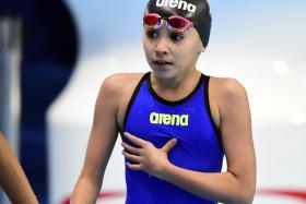 Alzain Tareq leaves the pool after her heats on Friday