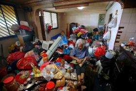 BEFORE AND AFTER: (Above) The Lim family's cluttered and filthy flat made headlines last week.
