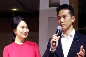 NEW PARENTS: Joanne Peh and Qi Yuwu at the gala premiere of local historical movie 1965 last Tuesday night.
