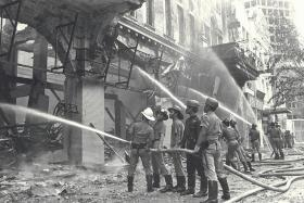 INFERNO: Firemen fought the fire which raged through Robinson's building at Raffles Place on Nov 21, 1972.