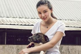 Socialite and animal lover Kim Lim raises funds for local shelter and got close to shelter dog named Lian Lian (above).