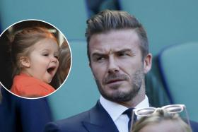 David Beckham lashed out at the Mail Online after it published an article about his daughter Harper (inset) using a pacifier.