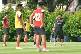 BOOST: LionsXII coach Fandi Ahmad (far right) and his charges can take confidence from beating Pahang, who were on a 12-match unbeaten run, ahead of their match with JDT.