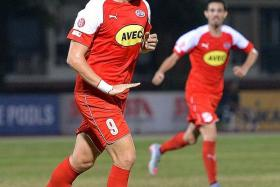 DANE ON THE DOUBLE: Home United's Ken Ilso celebrating after scoring the first of his two goals.