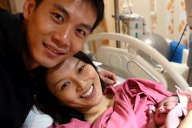 SUPPORTIVE: Qi Yuwu said he stood by Joanne Peh's side throughout her 16-hour labour till their baby daughter was born last Friday.