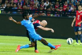 IN VAIN: JDT grabbed all three points through a superb effort by Luciano Figueroa (right).