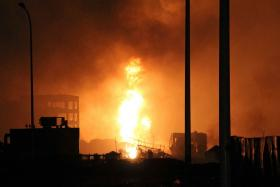 About 1,000 firefighters were dispatched to fight the blaze which was caused by the twio explosions on Wednesday.