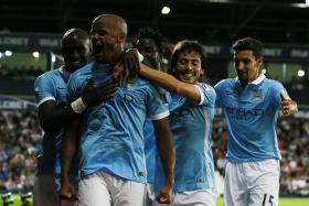 SUPER SKIPPER: Man City captain Vincent Kompany (second from left) leading the celebrations after scoring the third goal in their 