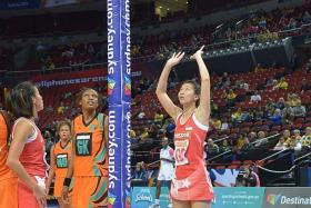 BITTERSWEET: Singapore goal shooter Charmaine Soh (right) earns her 50th cap in the 67-36 loss to Zambia yesterday.