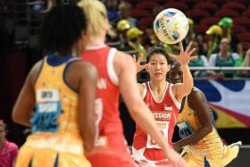 LOSING SIDES: There was no joy for Singapore's Charmaine Soh (above) and the Ugandans , who suffered defeats by Barbados and South Africa respectively, yesterday.