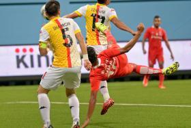SPECTACULAR: Khairul Nizam's (in red) scissors-kick earns his team a precious point.