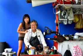FAMILY BUSINESS: Mr Yamaguchi sets up his stall in Yishun bus interchange (above) while his daughter Yoko sets hers outside Northpoint Shopping Centre.