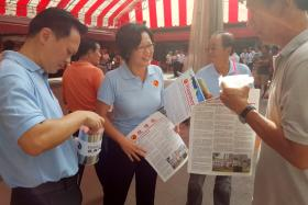 The Workers' Party's Sylvia Lim (second from left) at Chong Pang Market and Food Centre on Aug 16, 2015.