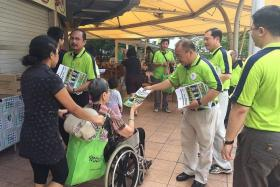 WALKABOUT: Singapore Democratic Alliance's Desmond Lim giving out brochures at Punggol Plaza yesterday.
