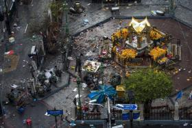 Experts investigate the Erawan shrine at the site of a deadly blast in central Bangkok, Thailand, August 18, 2015.