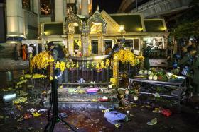 Experts investigate at the Erawan shrine, the site of a deadly blast in central Bangkok August 17, 2015.