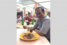 PAP MP Charles Chong posted a photo of Facebook of himself eating an oyster omelette in Aljunied.