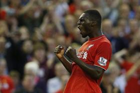 BRIGHT START: The goal by Christian Benteke (above) sees him join a list of players who scored on their Anfield debut.