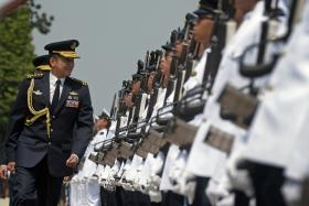 HANDOVER: Outgoing Chief of Defence Force Lt- Gen Ng Chee Meng inspects the guard of honour