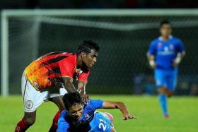 DOWN AND OUT: LionsXII's Safuwan Baharudin (above right, No. 21) falling under a challenge.