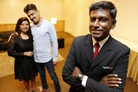 AWARD WINNER: Mr Daniel Ravindran and his parents, in the background.