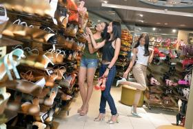 SHOE SHOPPING: (From left) Amy Syireen Marican, Denise Pung and Nikki Pang with the shoes they selected from New Look.