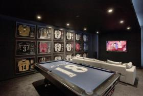 Phil Neville's Cheshire home has a pool table with his name and number emblazoned on it along other luxuries.