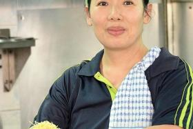 NOT ENOUGH HELP: Hawker Linda Heng relies on her husband and three part-timers to get by.