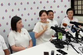 CONFIDENT: Ms Tin Pei Ling with her grassroots volunteers (from left) Ms Eunice Wang, Mr Mohamed Fauzi Ali and branch secretary Rosemary Lim at a press conference to announce that she will contest MacPherson SMC.