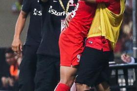 JOY: LionsXII goalscorer Hafiz Abu Sujad hugging goalkeeper Izwan Mahbud, an unused sub last night, as head coach Fandi Ahmad and assistant coach Nazri Nasir join in the celebrations.