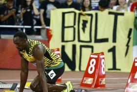 ON YOUR MARK: Usain Bolt is all poise and confidence as he lines up for the 100m heats.