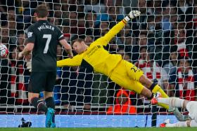 Arsenal's Olivier Giroud has a shot saved by Liverpool's Simon Mignolet