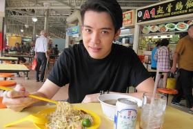 SOUP LOVER: Desmond Ng having his favourite Hokkien mee and pig organ soup at his childhood haunt, Ang Mo Kio Central Market & Food Centre.