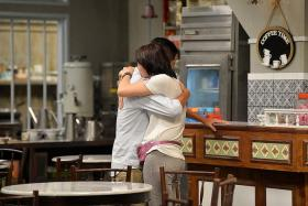 GOODBYE: Chew Chor Meng and Pan Lingling, who play a married couple in 118, share a tearful moment.