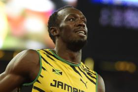 Usain Bolt celebrates winning the 200 metres final at the 2015 IAAF World Championships