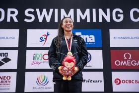 NEW MARK: New Zealand's Gabrielle Fa'amausili (above) takes the women's 50m backstroke gold in a world junior record time of 27.81 at the Fina World Junior Swimming Championships at OCBC Aquatic Centre.