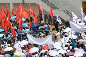Supporters from Workers' Party and Peoples' Action Party gather at Serangoon Junior College for the 2013 by-election Nomination Day.