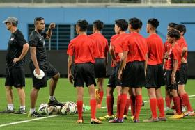 TOUGH START: Singapore U-15 coach V Selvaraj's (above, far left) boys will meet Thailand, winners of the AFC U-16 tournament in 1998, in the first match of the qualifiers.