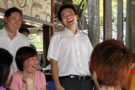Minister for Culture, Community and Youth Lawrence Wong (R) is contesting in Marsiling-Yew Tee GRC