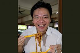 GOOD COOK: Mr Lawrence Wong, digging into the lor mee at the S-11 coffee shop in Choa Chu Kang Drive. He reveals that he is quite good at cooking.