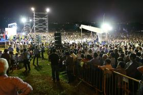 RAPT AUDIENCE: The crowd that gathered at the Hougang Central open field yesterday.