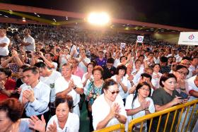 KICK-OFF: Mr Chan Chun Sing addressing supporters at PAP's first rally at Delta Hockey Pitch in Tiong Bahru.