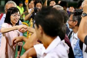 FIRST-TIMER: Ms Han Hui Hui at her rally at Delta Hockey Pitch yesterday.
